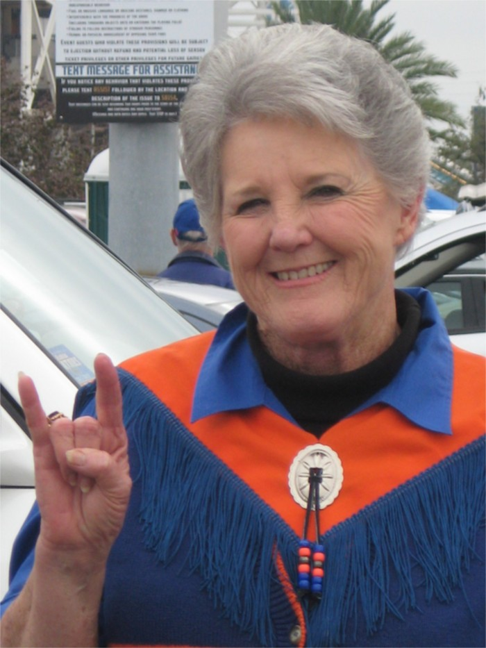 Ann and Hook Em Horns Texas Gator fan photo by Kathy Miller