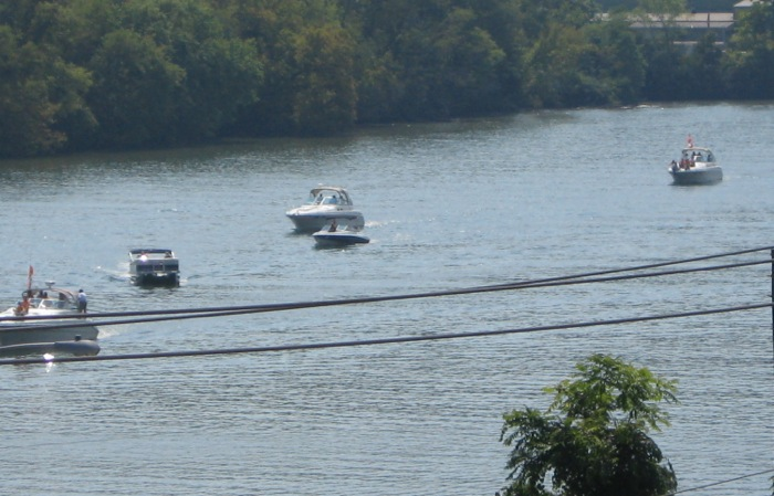 Boats making their way up the Tennessee River for Vol Navy Knoxville photo by Kathy Miller