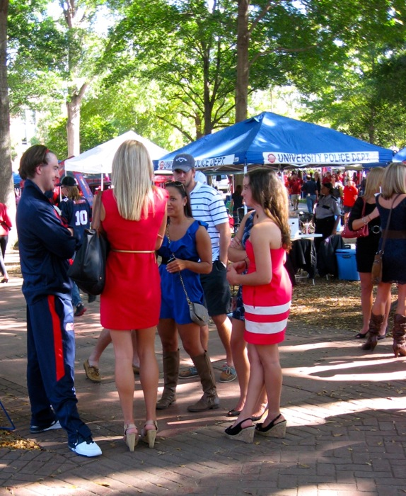 Dresses and high heeled shoes and boots at a tailgate in The Grove photo by Kathy Miller