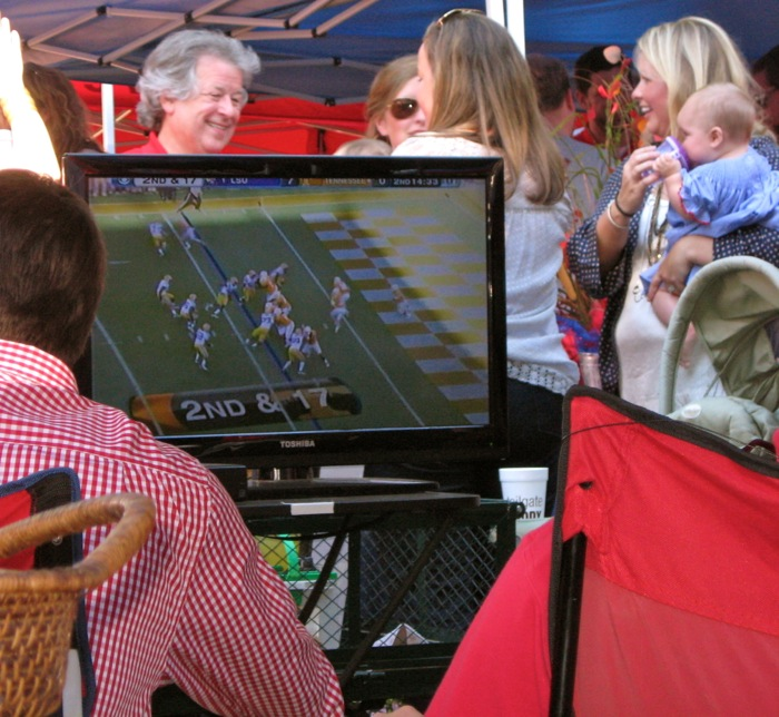 Tailgating at Ole Miss Tennessee Lsu game on tv at tailgate in the Grove photo by Kathy Miller