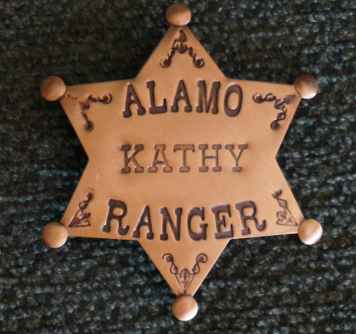 Alamo Kathy Ranger sheriff's badge for the Texas A&M game photo by Kathy Miller