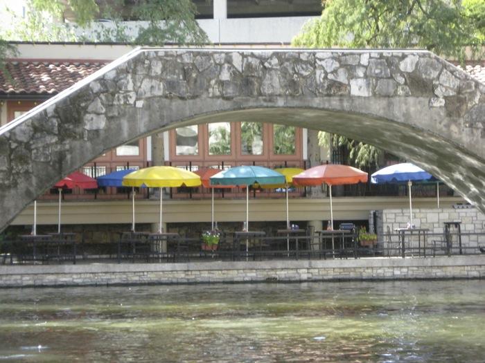 River Walk San Antonio Texas multi colored umbrellas outdoor cafes photo by Kathy Miller
