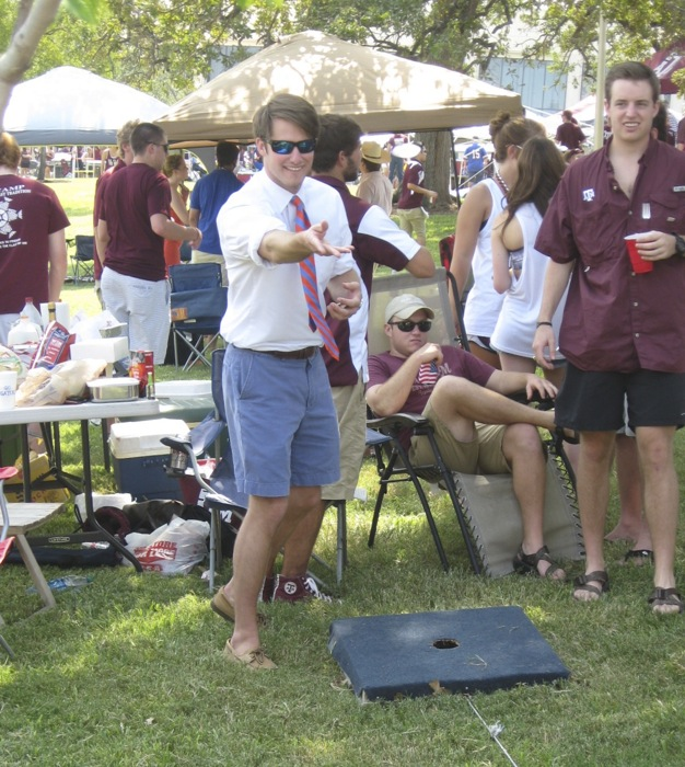Gator James and Aggie cornhole photo by Kathy Miller