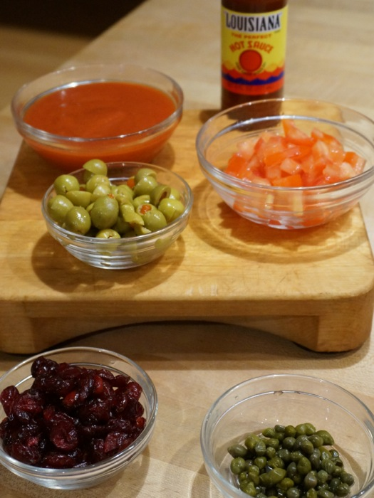 Louisiana Picadillo ingredients tomato sauce, green olives chopped tomatoes, dried cranberries and capers...and your favorite hot sauce photo by Kathy Miller