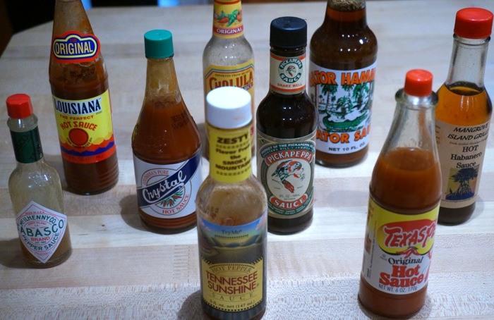 Favorite Hot Sauces, Tabasco, Louisiana Hot Sauce, Tennessee Sunshine, Crystal, Texas Pete photo by Kathy Miller