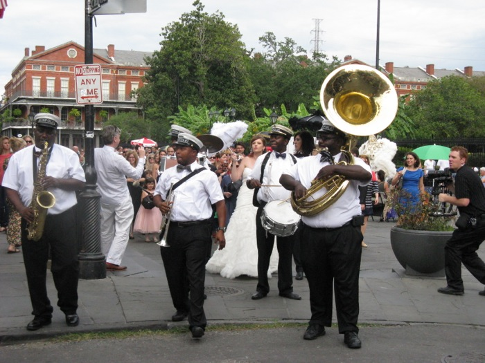 Wedding Celebration New Orleans with band, marching down the street photo by Kathy Miller