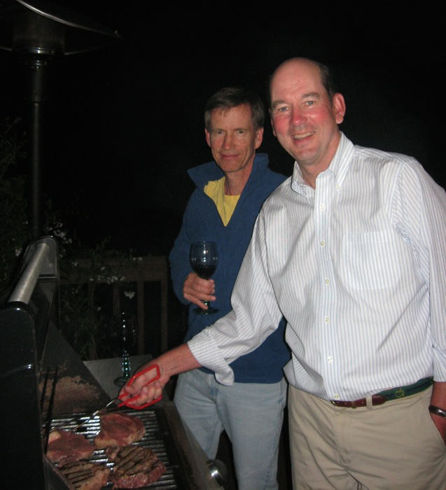 Bill is in charge of the steak grilling with Dave supervising photo by Kathy Miller
