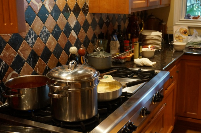 Stove top with pots, pans and sauces photo by Kathy Miller