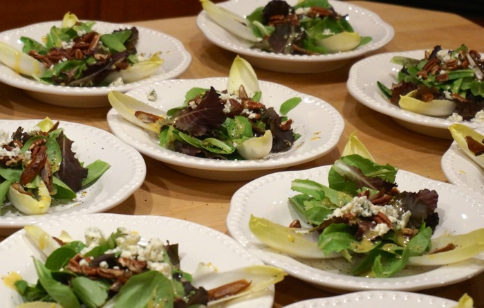 Mixed Greens with Endive, Dates, Pecans,  and Crumbled Goat Cheese with a Shallot Infused Vinaigrette photo by Kathy Miller