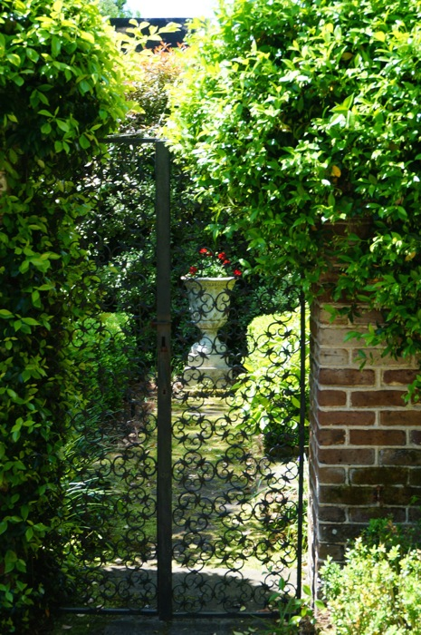 The urn in the rear garden with iron gates photo by Kathy Miller