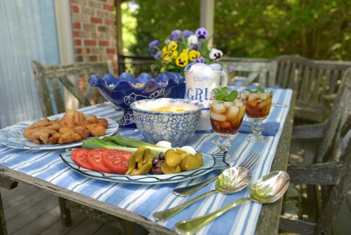 Catfish Fry table spread with blue and white tablecloth and serving pieces photo by Joy McCabe