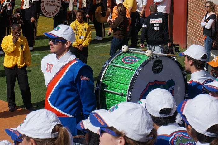 Gator Drummer watching UT drumline pregame warmup drill photo by Kathy Miller