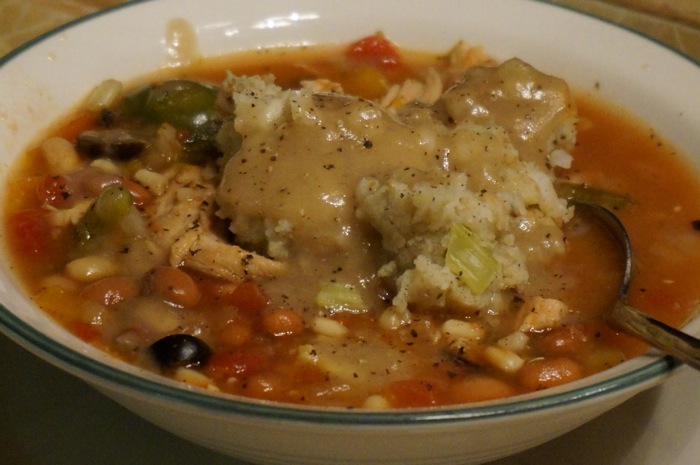 Potato Stuffing drizzled with Turkey Gravy tops a Kitchen Sink Soup photo by Kathy Miller