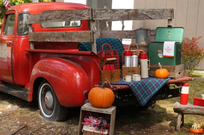 Vintage Tailgate, red truck, vintage Thermos picnic containers, vintage cooler photo by Kathy Miller