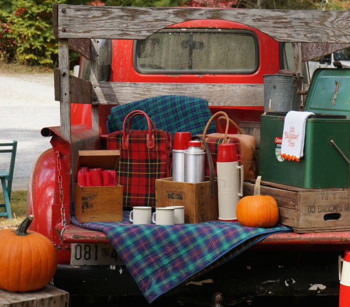 Rear view of vintage tailgate with Thermos coolers photo by Kathy Miller