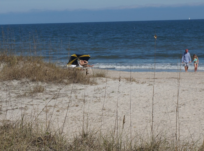 Iowa fan relaxes on beach at Amelia Island Omni photo by Kathy Miller