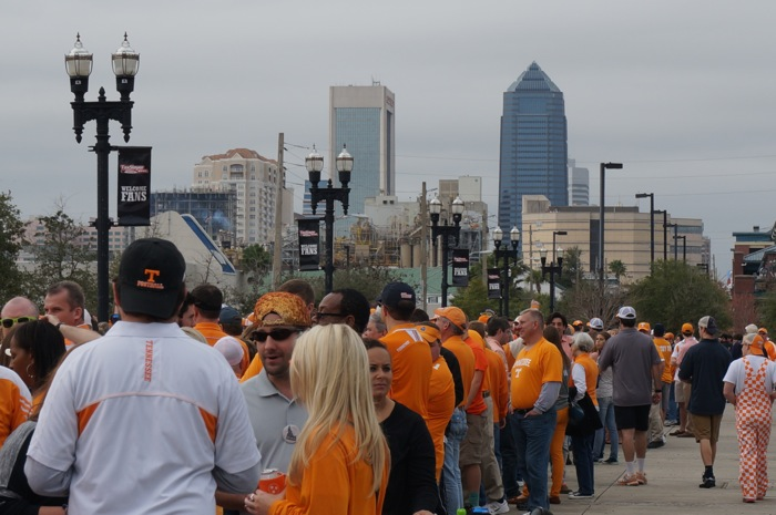 fans wait for Tennessee Vol Walk with Jacksonville skyline in background photo by Kathy Miller