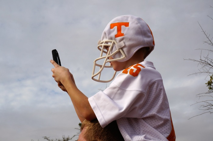 Young Tennessee fan captures Vol Walk from his dad's shoulders photo by Kathy Miller