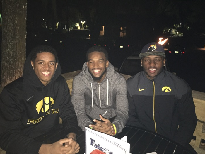 Iowa players take a break during TaxSlayer Bowl photo by Kathy Miller