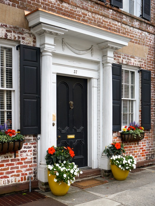 Great Charleston House with yellow pots filled with flowers photo by Kathy Miller