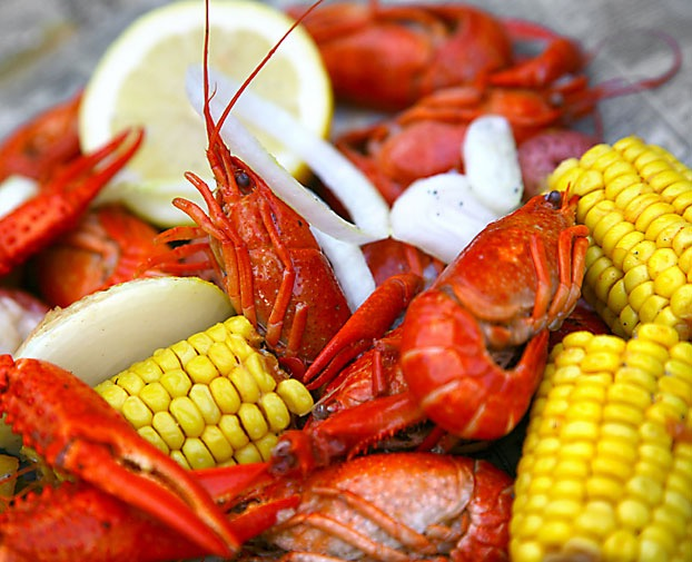 crawfish boil with potatoes, corn, onion and lemon and lots of spice