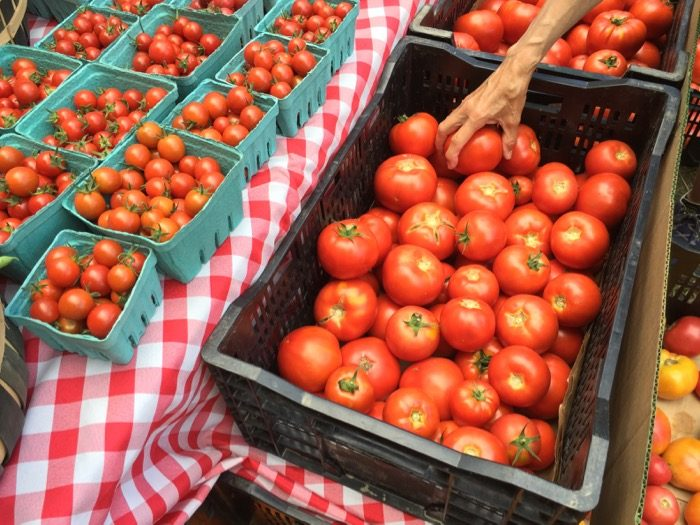 Reaching for the Heirlooms at the Dorset Farmers Market photo by Kathy Miller
