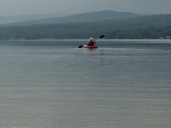 Janet kyaking on Seymour Lake photo by Kathy Miller