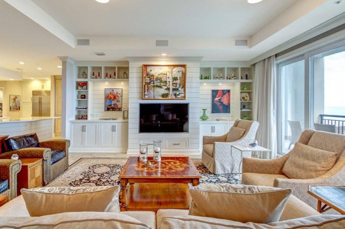 Spyglass Living with artwork displayed on shiplap walls