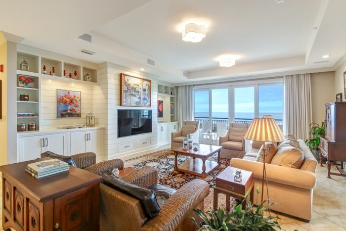 Spyglass Living with center TV and Dennis Campay painting over TV