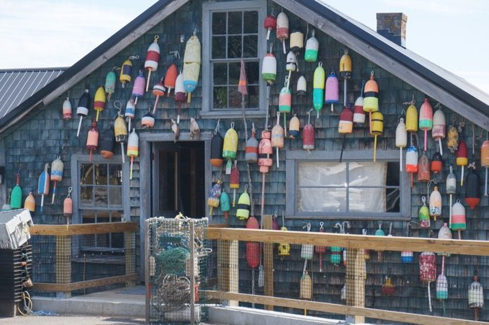 The buoy wall beside Thurston's Lobster Pound photo by Kathy Miller