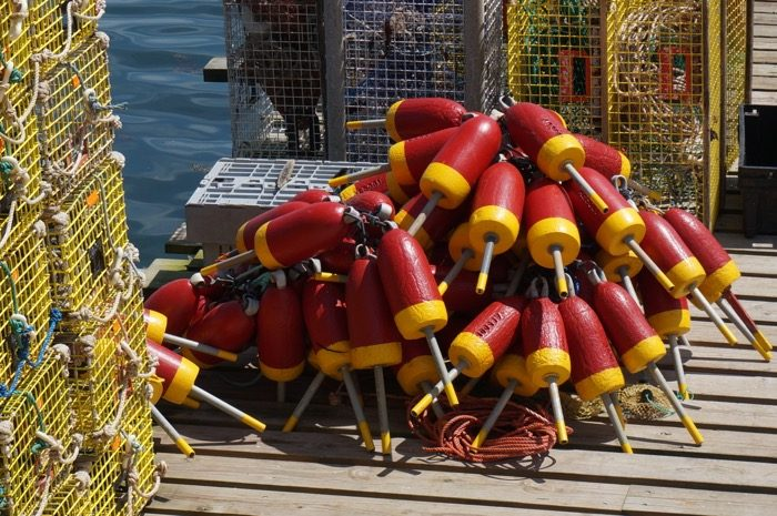 Buoys piled on the dock outside Thurston's Lobster pound photo by Kathy Miller
