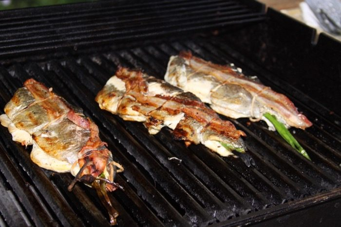 Cooked bacon wrapped mountain trout photo by Kathy Miller
