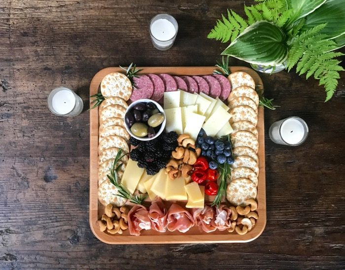 Cheese Board for the 4th of July on antique table photo by Kathy Miller