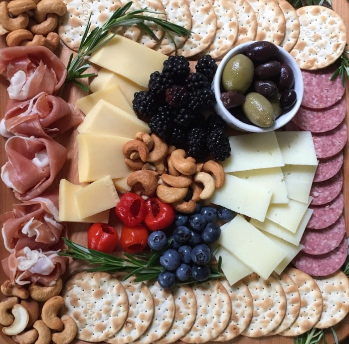 Cheese board close up with proscuitto florets photo by Kathy Miller