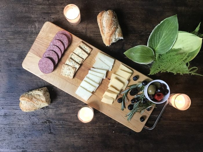 Simpler cheese board on Vermont cutting board photo by Kathy Miller