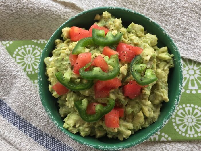 Guacamole with Jalapeno and tomatoes photo by Kathy Miller