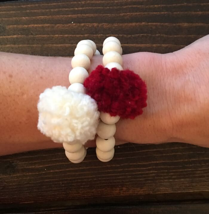 Oklanoma Crimson and Cream Pom Pom Bracelet stack