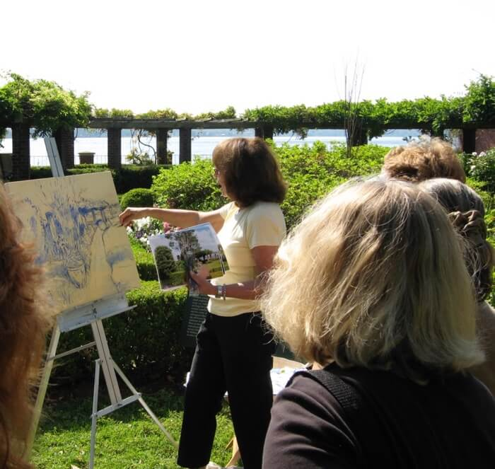 Ellen Diamond painting in the Cummer Gardens photo by Kathy Miller