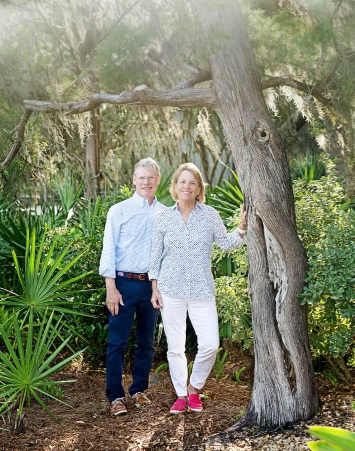 Doug and Amy Wilsterman with favorite cedar tree photo by Susan Scarborouigh