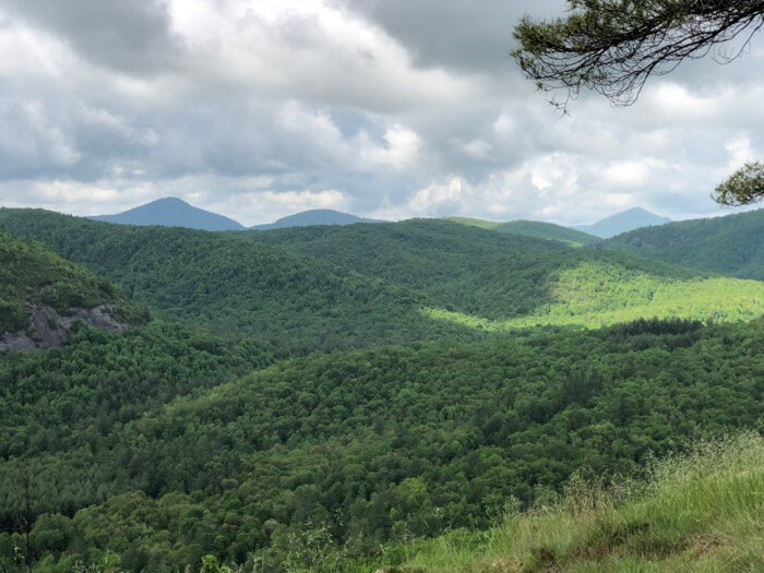 View of Chimney Top Mountain, Rock Mountain and Whiteside Mountain from Blackrock Mountain in Panthertown photo by Kathy Miller