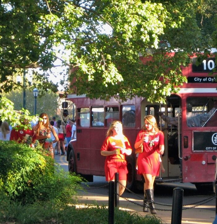 Red double decker bus traveling to and from The Grove and Oxford photo by Kathy Miller
