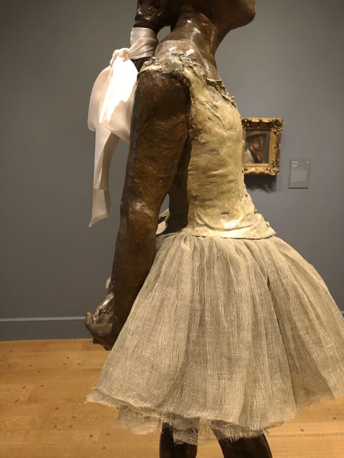 Degas bronze dancer unclose of gauze tutu and silk ribbon photo by Kathy Miller