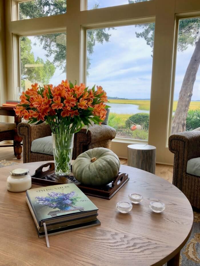 Heirloom pumpkin, orange flowers and my favorite flower book by Lewis Miller photo by Kathy Miller