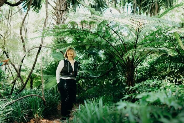 Becky Grimes under her Australian Tree Fern
