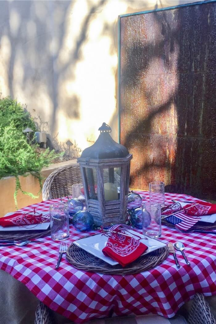 Lanterns with red and white check tablecloths