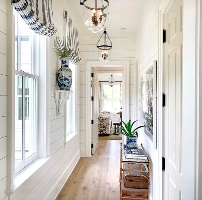 Hall downstairs leading to master bedroom Southern Living 2019 Idea House