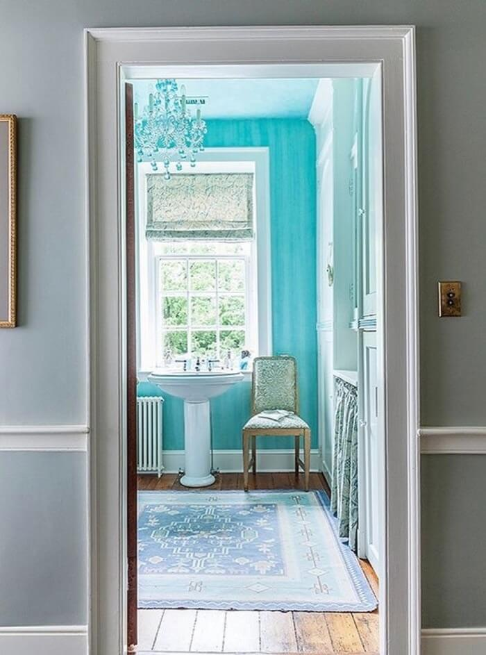 Jewelry designer Elizabeth Locke with colorful bathroom and patterned sink skirt