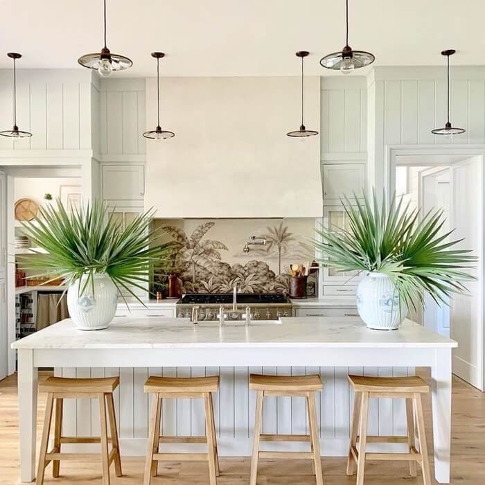 Kitten with hand painted panels and a grid lighting instead of island pendants Southern Living 2019 Idea House