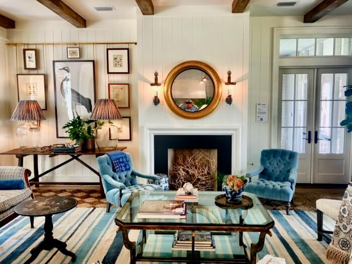 Living room with layered rugs and wood beams Southern Living 2019 Idea House