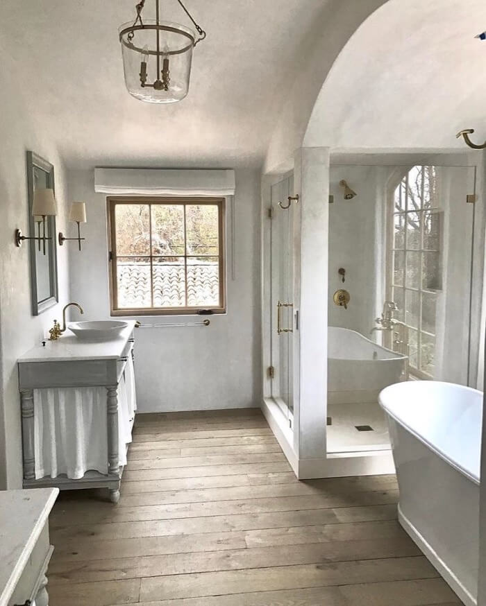 Modern and rustic bathroom with skirt sink Brooke Giannetti